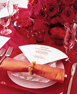 Red and tangerine place setting