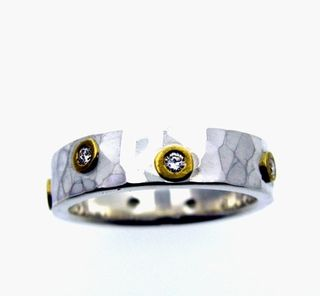Silver and gold diamond hammered band