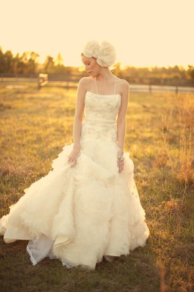 Bride in grass with flower in hair