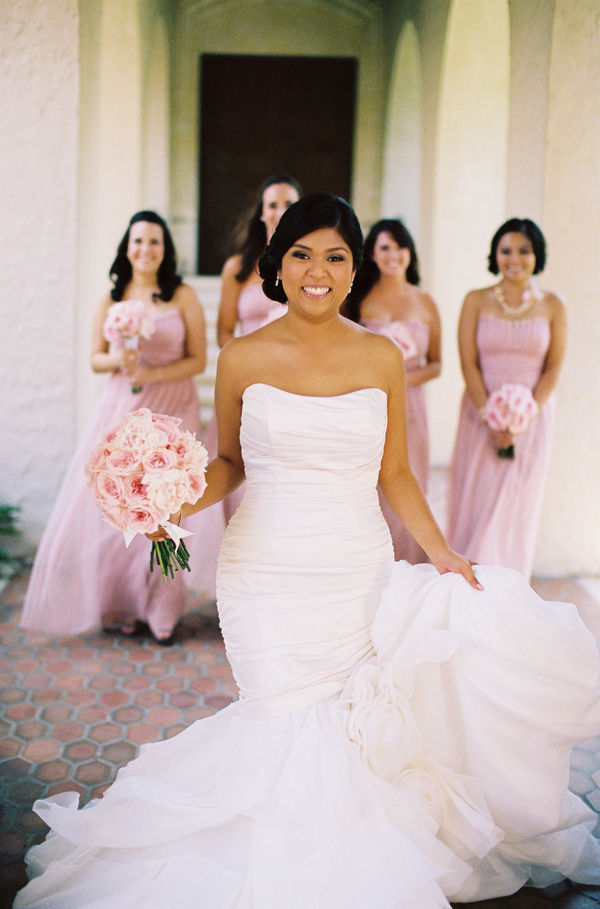 gown with pink bridesmaids