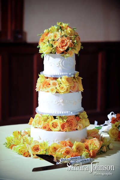 Orange and yellow wedding cake flowers